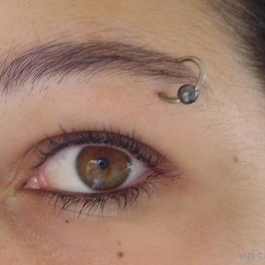 Girl-With-Eyebrow-Piercing-On-Left-Ear.jpg}